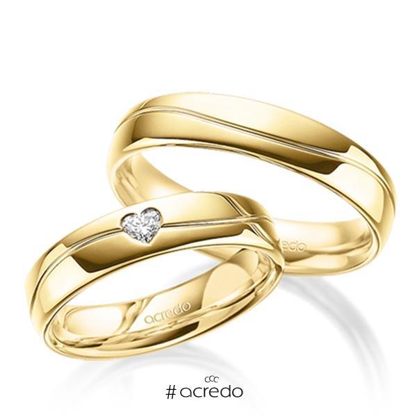 Paar klassische Trauringe/Eheringe in außen Gelbgold 585 , innen Gelbgold 585 mit zus. 0,1 ct. Herz-Diamant tw, vs von acredo