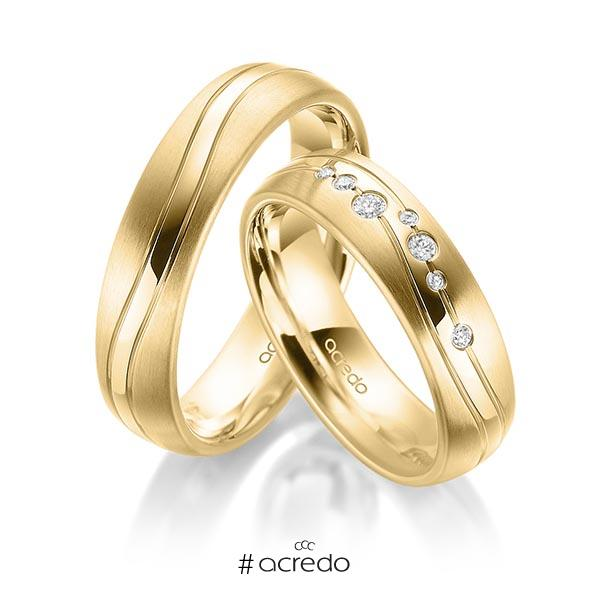 Paar klassische Trauringe/Eheringe in Gelbgold 585 mit zus. 0,085 ct. Brillant tw, si von acredo