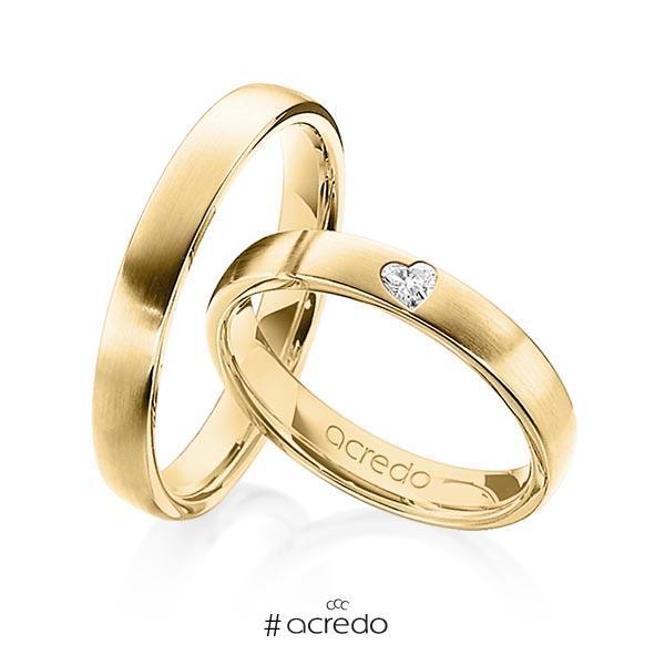 Paar klassische Trauringe/Eheringe in Gelbgold 585 mit zus. 0,08 ct. Herz-Diamant tw, vs von acredo