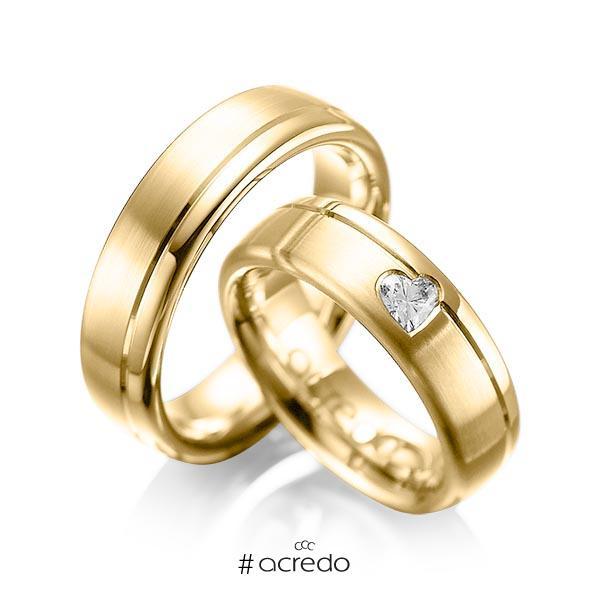 Paar klassische Trauringe/Eheringe in Gelbgold 585 mit zus. 0,22 ct. Herz-Diamant tw, vs von acredo